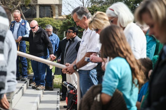 People hold hands as they pray in a prayer rally Tuesday, Jan. 22, 2019, at the Tom Green County Courthouse. The pro-life event was set on the 46th anniversary of the Supreme Court ruling on Roe v. Wade.