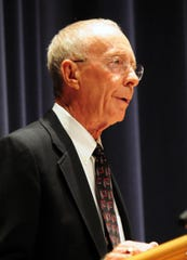091410--Laura Emmons photo-- Kelly Shumate, former principal for Snow Hill High School, shares his memories at a memorial service and celebration of life for longtime athletic director and Snow Hill boys basketball coach Allen Miller Sr. at Stephen Decatur High School on Tuesday. People packed the auditorium and others watched on tv screens in the library and media rooms as Miller was remembered for his passion, friendship, and dedication to his family, students and community.