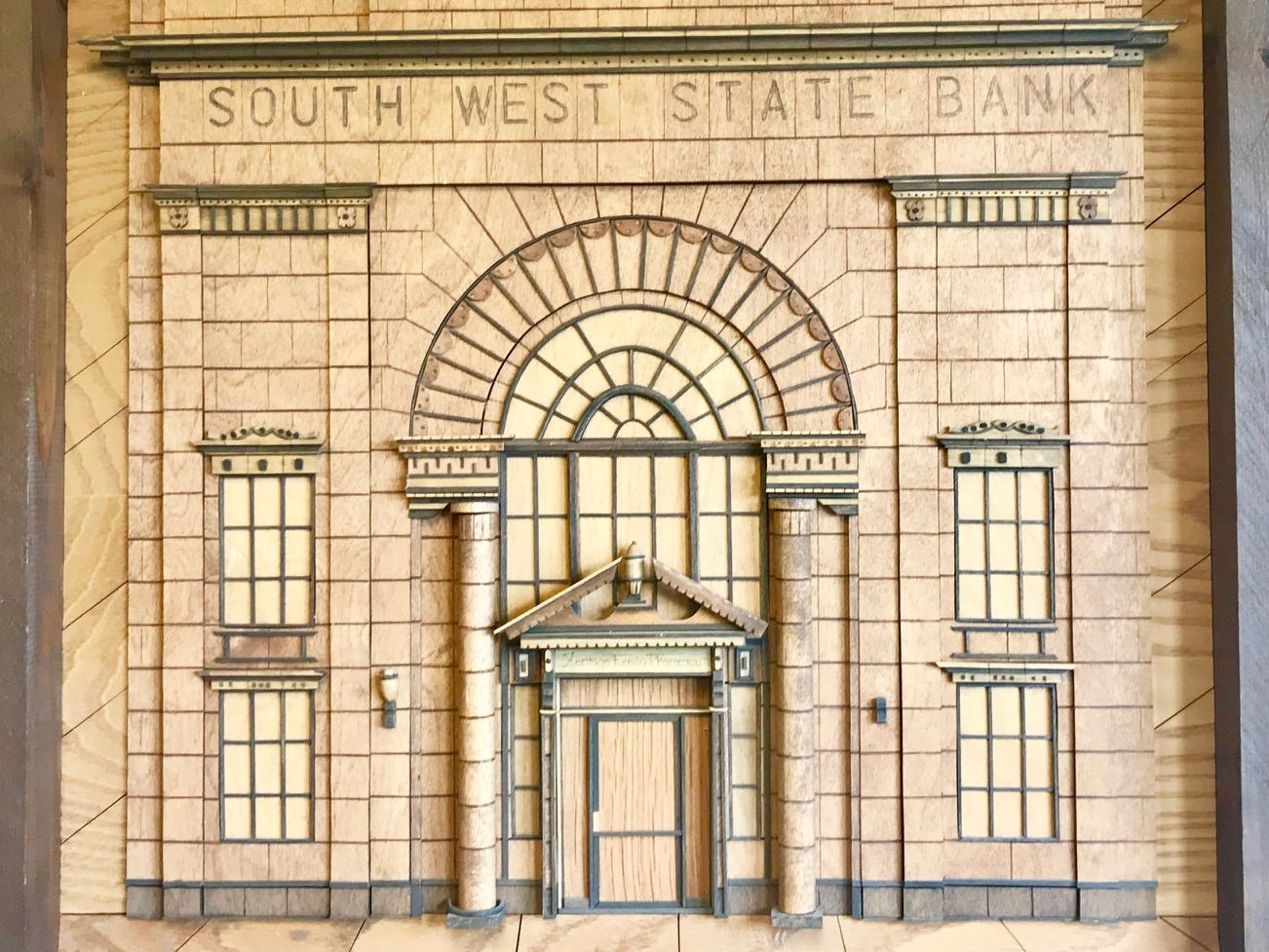 The historic building was once a bank. This mural showcases what the original entrance looked like.