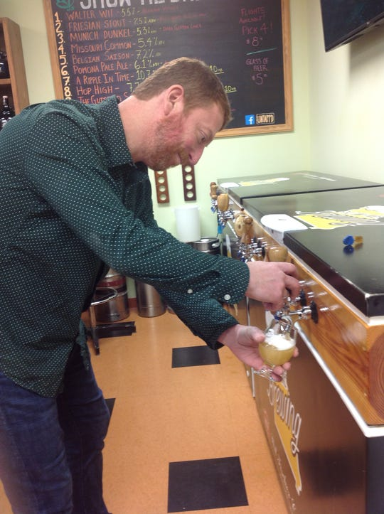 Andy Pearsall pours a beer at Show Me Brewing. They keep 12 brews on tap and they rotate frequently.