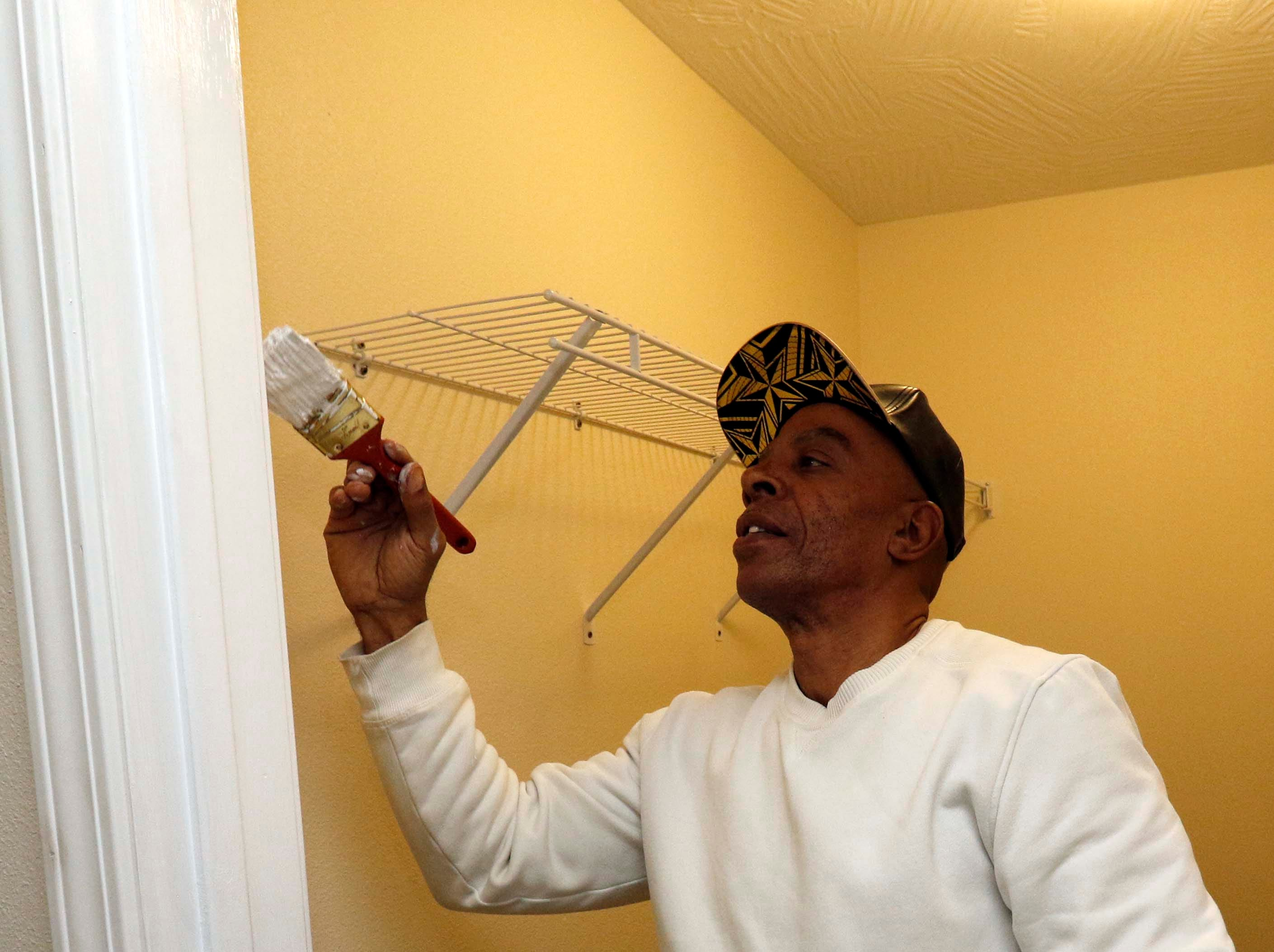 Leo Taylor-Bey works on the new Habitat for Humanity house on North Main in Springfield on Jan. 18, 2019.