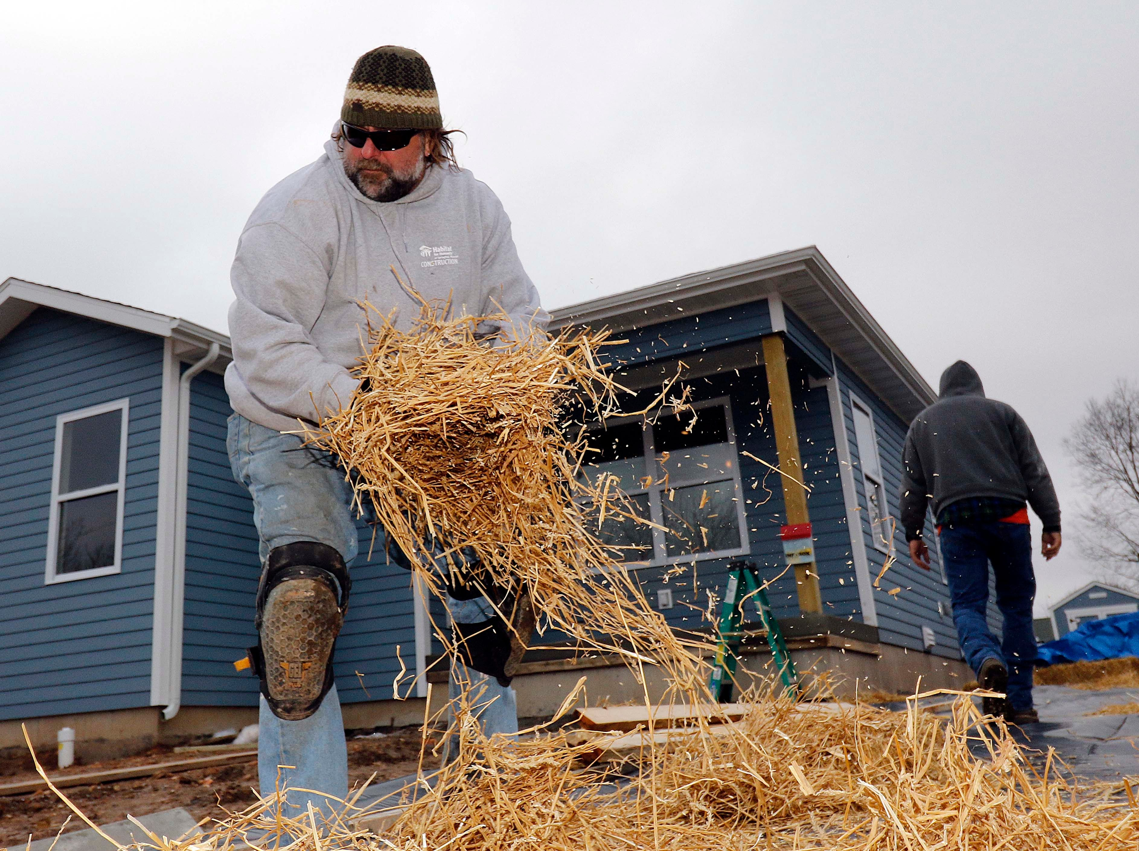 Kurt Jentzsch seen here covering the driveway at the new Habitat for Humanity house on North Main in Springfield on January 18, 2019.