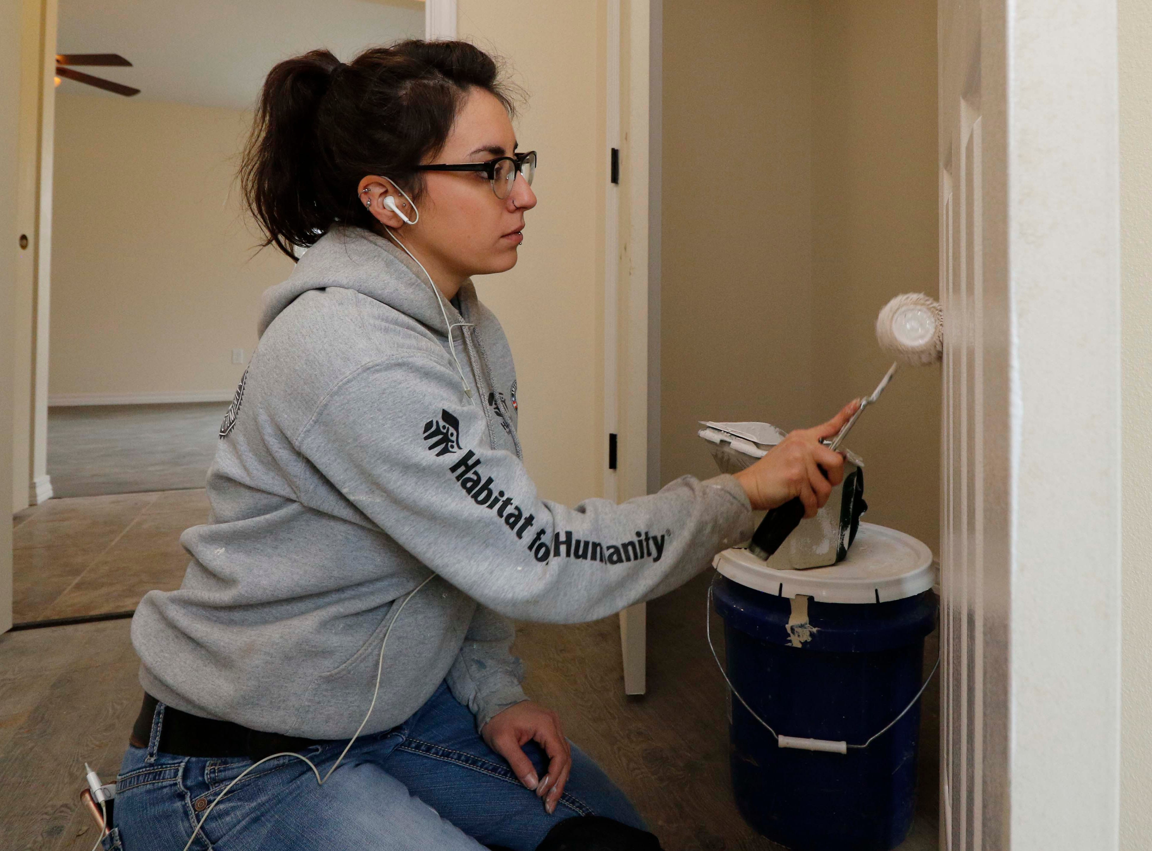Shannon Calton works on the new Habitat for Humanity house on North Main in Springfield on Jan. 18, 2019.
