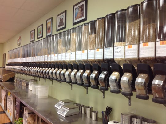 An entire wall at Show Me Brewing is set up like the bulk section of a grocery store where customers can shop for grains and other beer-making ingredients.