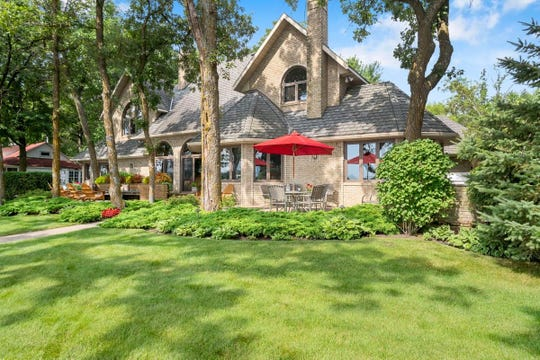 The 1.61-acre property is immaculate, boasting a wide array of mature trees and perennial flower beds.
