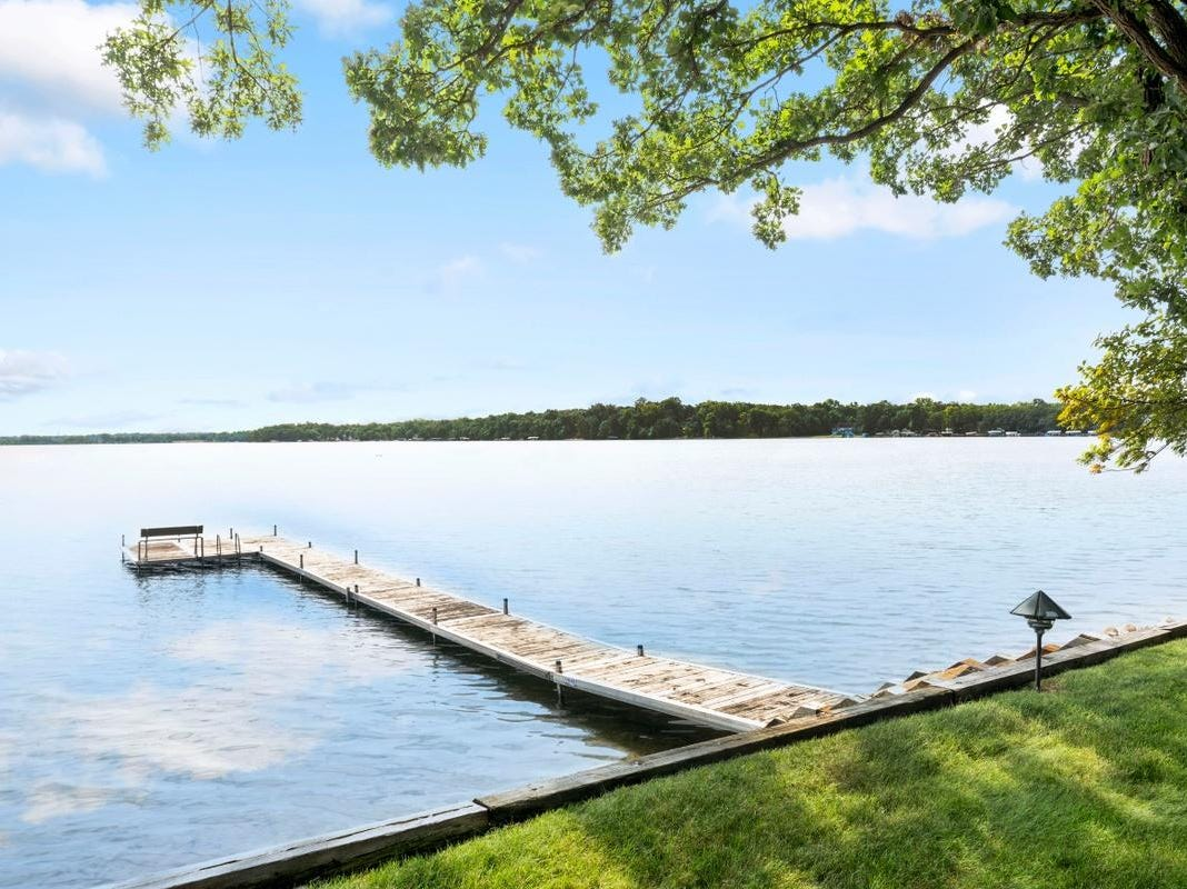 The home enjoys a spectacular view of Lake LeHomme Dieu.