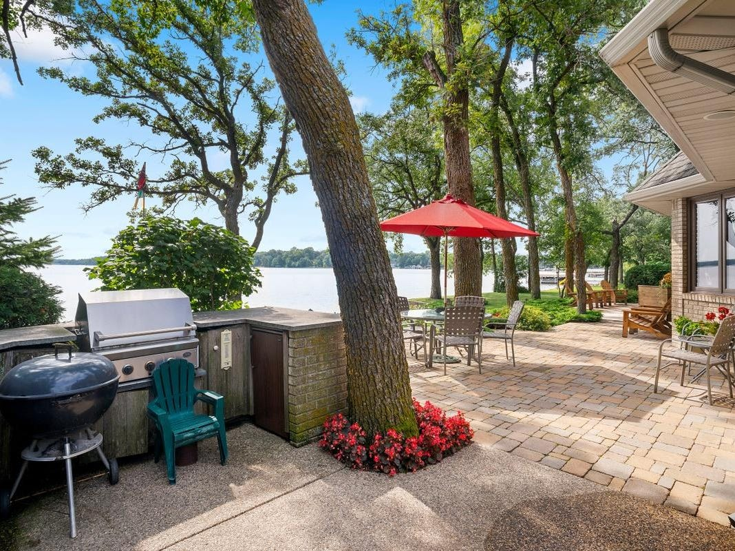 The backyard features a cedar deck and a paverpatio with a permanent outdoor kitchenette.