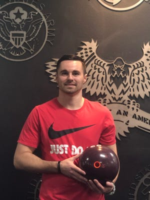 Kyle Clark poses after rolling his second career 300 game at Sunset Lanes in St. George. A graduate of Cedar High and Dixie State University, Clark ranks among the area's best bowlers.