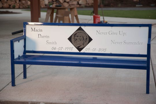 Family and friends of Macin Smith dedicate a bench in his honor at Crimson Ridge Park Monday, Jan. 21, 2019.