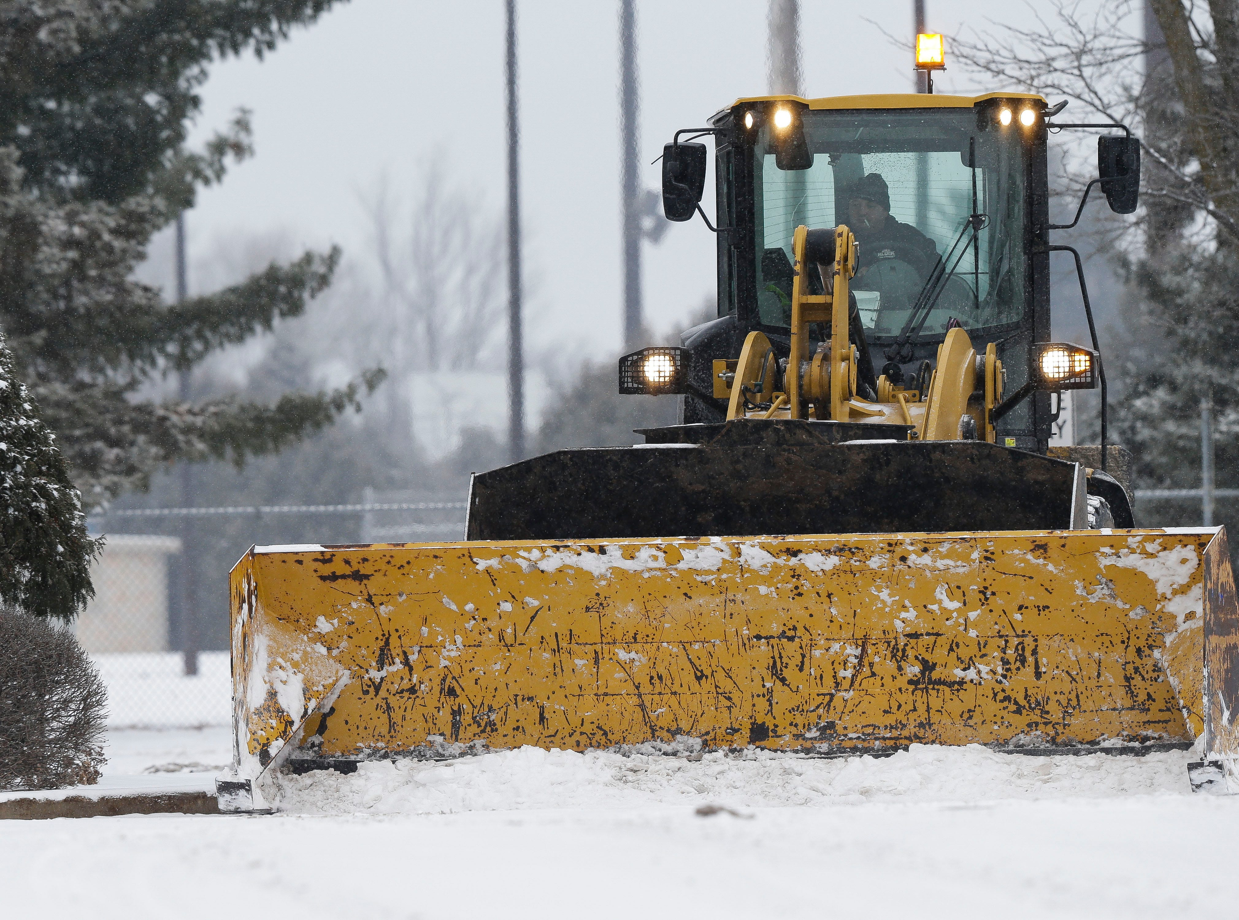 A snow plow clears a parking lot on Tuesday, January 22, 2019, in Stevens Point, Wis. A snow storm rolled through the area on Tuesday and is expected to drop 6-8 inches of snow.Tork Mason/USA TODAY NETWORK-Wisconsin
