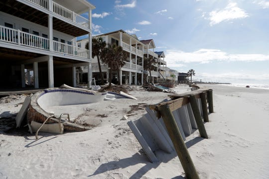 A vacation home managed by Coastline Vacation Rentals was ravaged by Hurricane Michael on Oct. 10, 2018. Three months later, the beachfront pool is still uprooted and filled with sand in Port St. Joe, Friday, Jan. 18, 2019.
