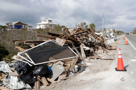 Debris lines the streets of Port St. Joe, Friday, Jan. 18, 2019, as homeowners continue to recover and rebuild from the destruction caused by Hurricane Michael.