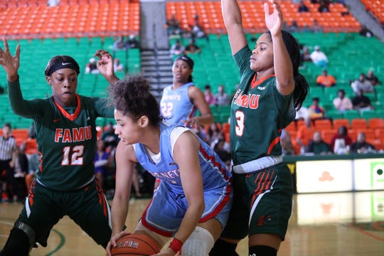 Jhakya Dilworth (12) and Candice Williams tighten up on defense versus Delaware State