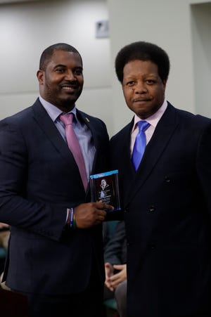 FAMU football coach Willie Simmons received the Martin Luther King, Jr. Service Award by the Inter-Civic Council of the Southern Christian Leadership Council from District 1 County Commissioner Bill Proctor on Tuesday, Jan. 22, 2019.