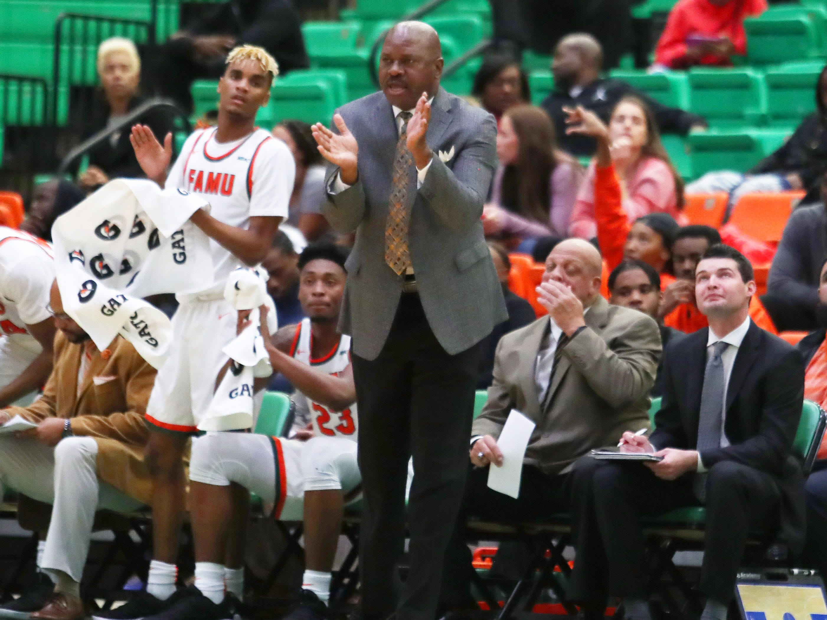 FAMU men's basketball coach Robert McCullum cheers on the team at the Al Lawson Multipurpose Center.