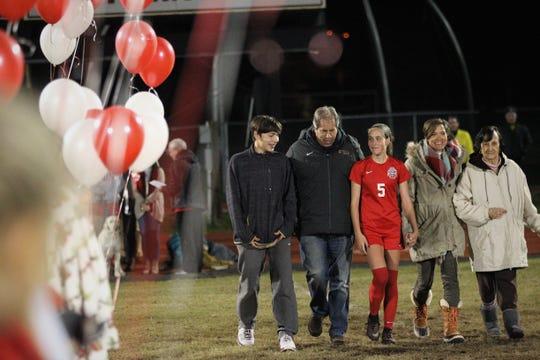 Leon senior Allie Krikorian is recognized on Senior Night alongside her family, including her father Mark Krikorian, Florida State's soccer coach.