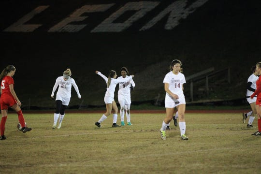 Janae Scott (9) celebrates her game-winning goal with teammates as Florida High's girls soccer team beat Leon 3-2 on Jan. 21, 2019.