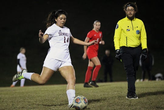 Florida High senior Rubi Castro kicks a pass forward as Florida High's girls soccer team beat Leon 3-2 on Jan. 21, 2019.