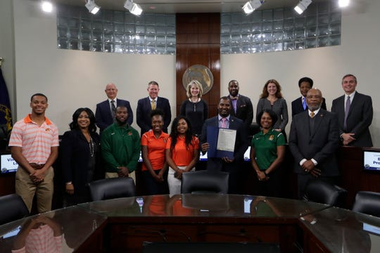 FAMU athletics received a proclamation by the Leon County Board of County Commissioners for their community service in the aftermath of Hurricane Michael on Tuesday, Jan. 22, 2019. From L-R: FAMU attendees included were wide receiver Dock Luckie, Executive Director of Alumni Affairs Carmen Cummings-Martin, defensive back Terry Jefferson, tennis players Sophia Osabuohein and Mialiniaina Rakotondrazafy, football coach Willie Simmons, tennis Nikki Goldthreate and Athletics Director Dr. John Eason.
