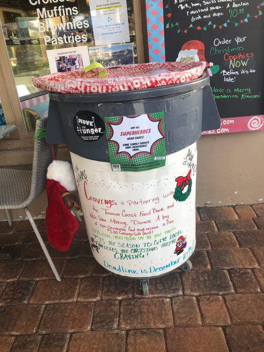 In Indian River County, the winner for most amount of non-perishable food collected for the White Glove Moving Holiday Food Drive was Cravings and The Beached Whale on Ocean Drive in Vero Beach.