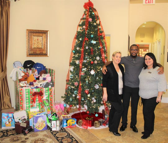 Kitterman Woods Apartments residents and staff, as well as others from the community, helped collect Gifts for Teens over the holidays. Pictured, from left, Penny Killen, manager; Rakeem Brown, assistant manager; and Melody Vazquez, leasing specialist.