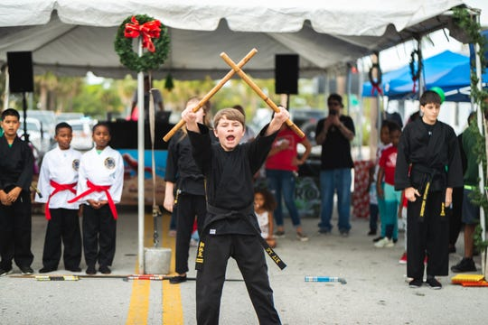 Sidekick Martial Arts students perform at LeGit's Downtown Toy Drive Block Party in Fort Pierce.