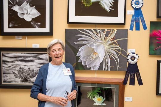 "Roberta Lundon with 2018 Best in Show ""Night Bloom"" from Treasure Coast Photography Center's ""From the Heart"" Juried Exhibition."