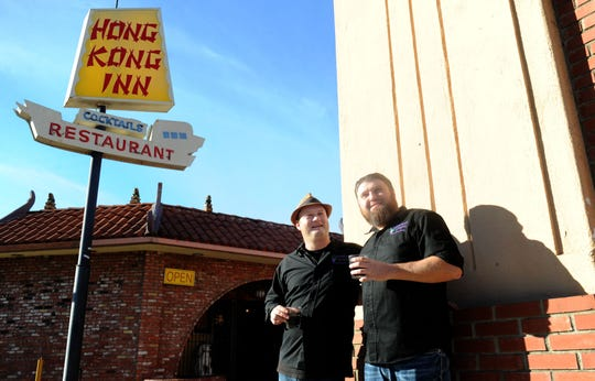 "Squashed Grapes owners Adam Randall, left, and Josh McNutt pose in front of the Hong Kong Inn in Ventura, where they have temporarily taken over front-of-the-house operations while waiting for their combination winery, wine bar and live jazz venue to reopen. Their ""The Grape Presents"" series features live music most Tuesdays through Saturdays."