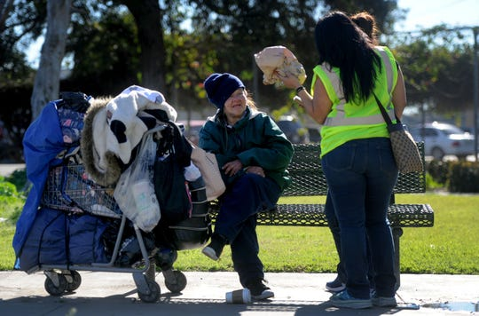 Monica Marquez, left, talks to volunteers Claudia Lozano, middle, and Maria Ramirez at Wilson Park in Oxnard during the 2019 Ventura County Homeless Count on Tuesday. Marquez has been homeless for four years.