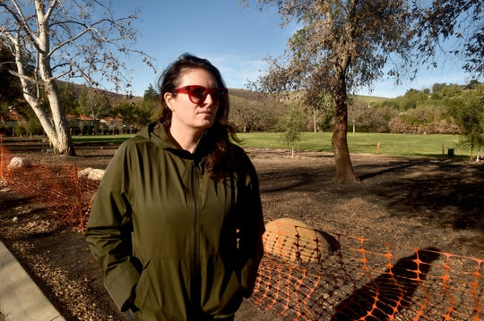 Neighbors of North Ranch Neighborhood Park in Thousand Oaks are upset that the Conejo Recreation and Park District plans to lay down new wood mulch in the park to replace the wood mulch that burned in the Woolsey Fire, causing damage to some of their luxurious homes. Pictured is one of the neighbors, Alison Manger.