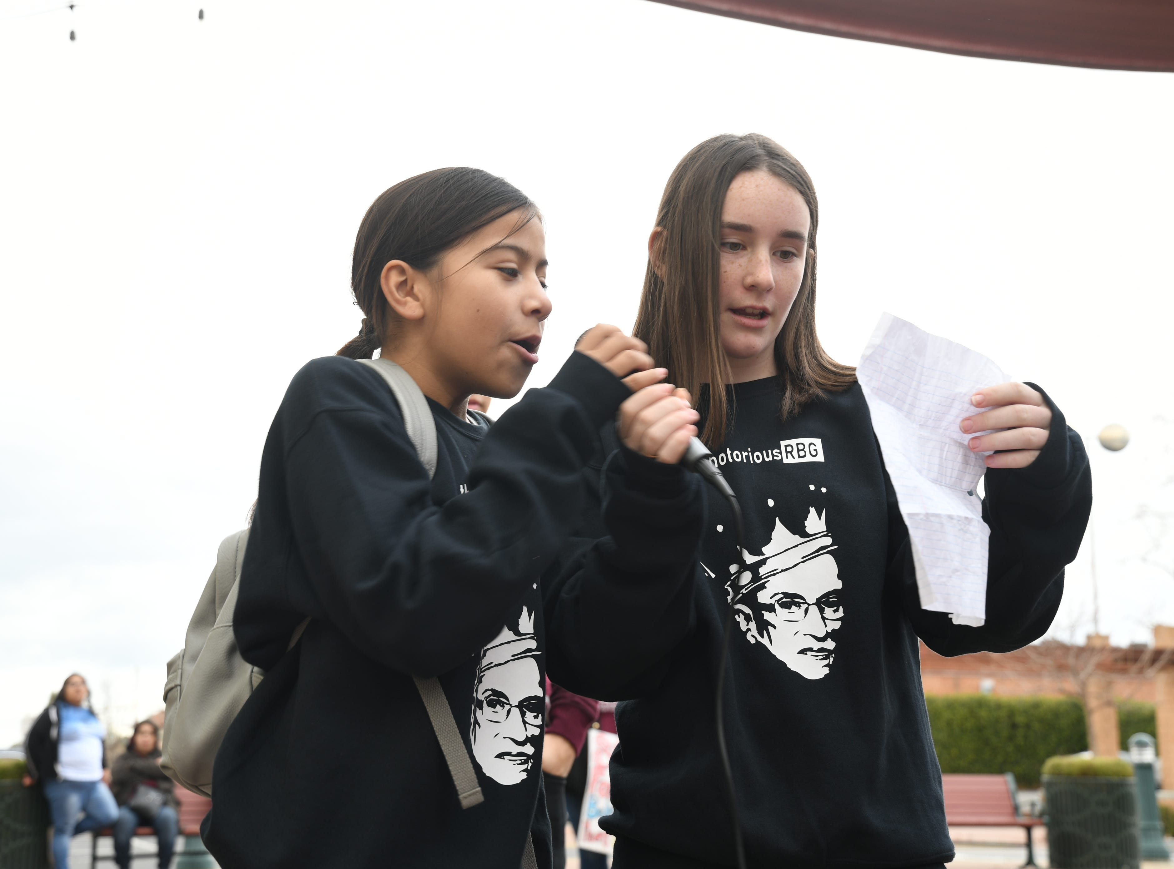 """Avery Voss, 12, and Daniella Rocha, 11, wear matching """"Notorious RBG"""" sweaters as they speak of their admiration for the supreme court justice."""
