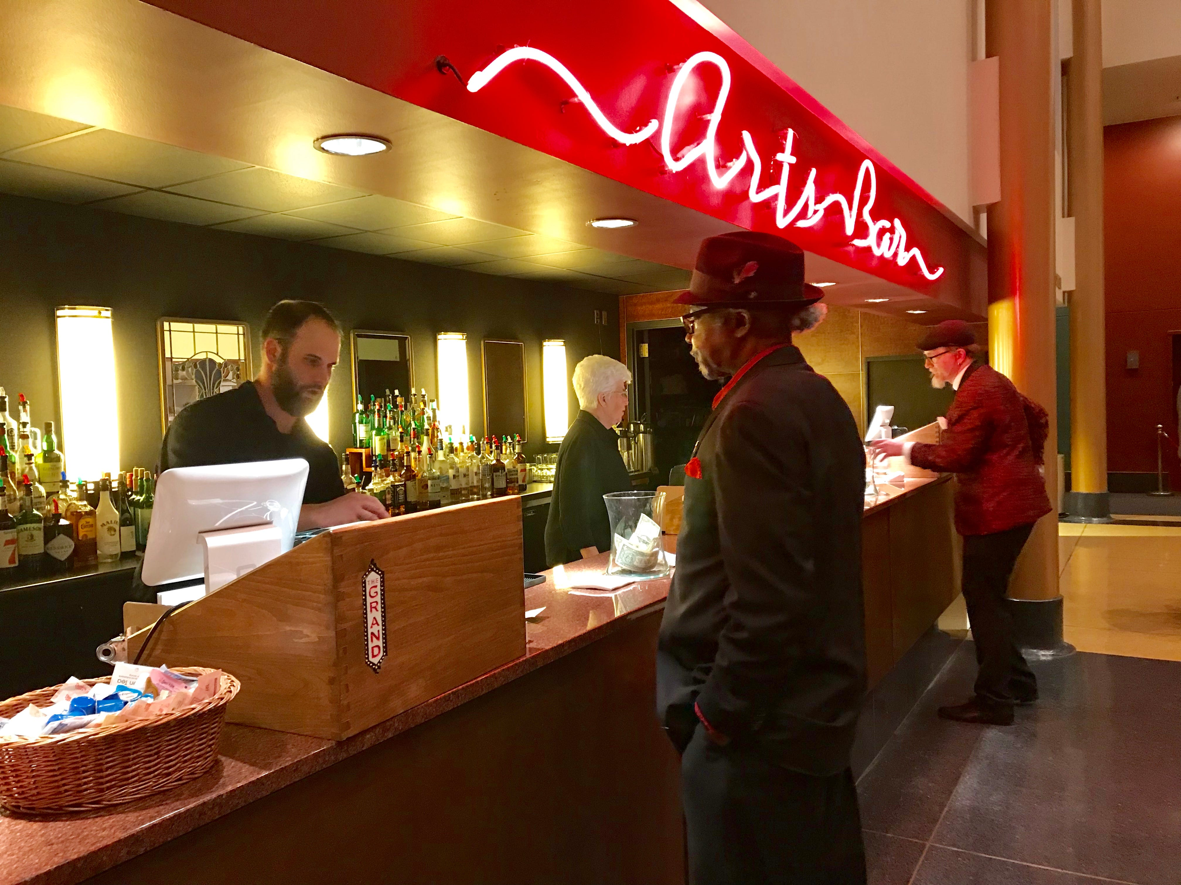 People order from the bar at the MLK Day celebration at the Grand Theater in Wausau.