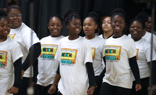 The East Ramapo Marching Band Color Guard perform during the Unity Celebration and talent showcase honoring Rev. Martin Luther King Jr. at Ramapo High School in Spring Valley Jan. 21, 2019.