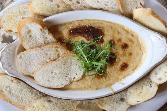 Welsh Rarebit is a warm blend of English cheddar and Stilton cheeses and Smithwick's Irish Ale, served with crostini for dipping.