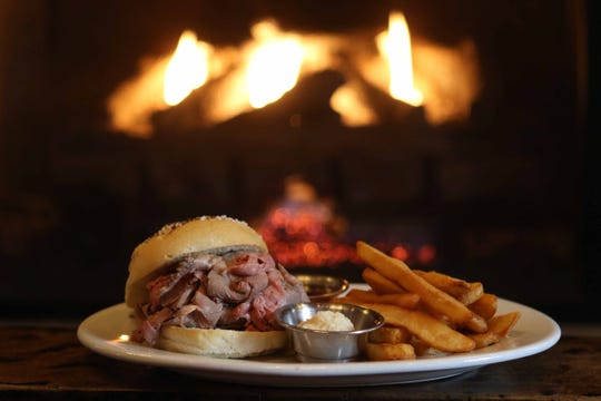 The Beef on Weck is a thinly sliced, locally raised grass-fed beef on a Kummelweck roll served with a side of fresh horseradish, au jus and chips.