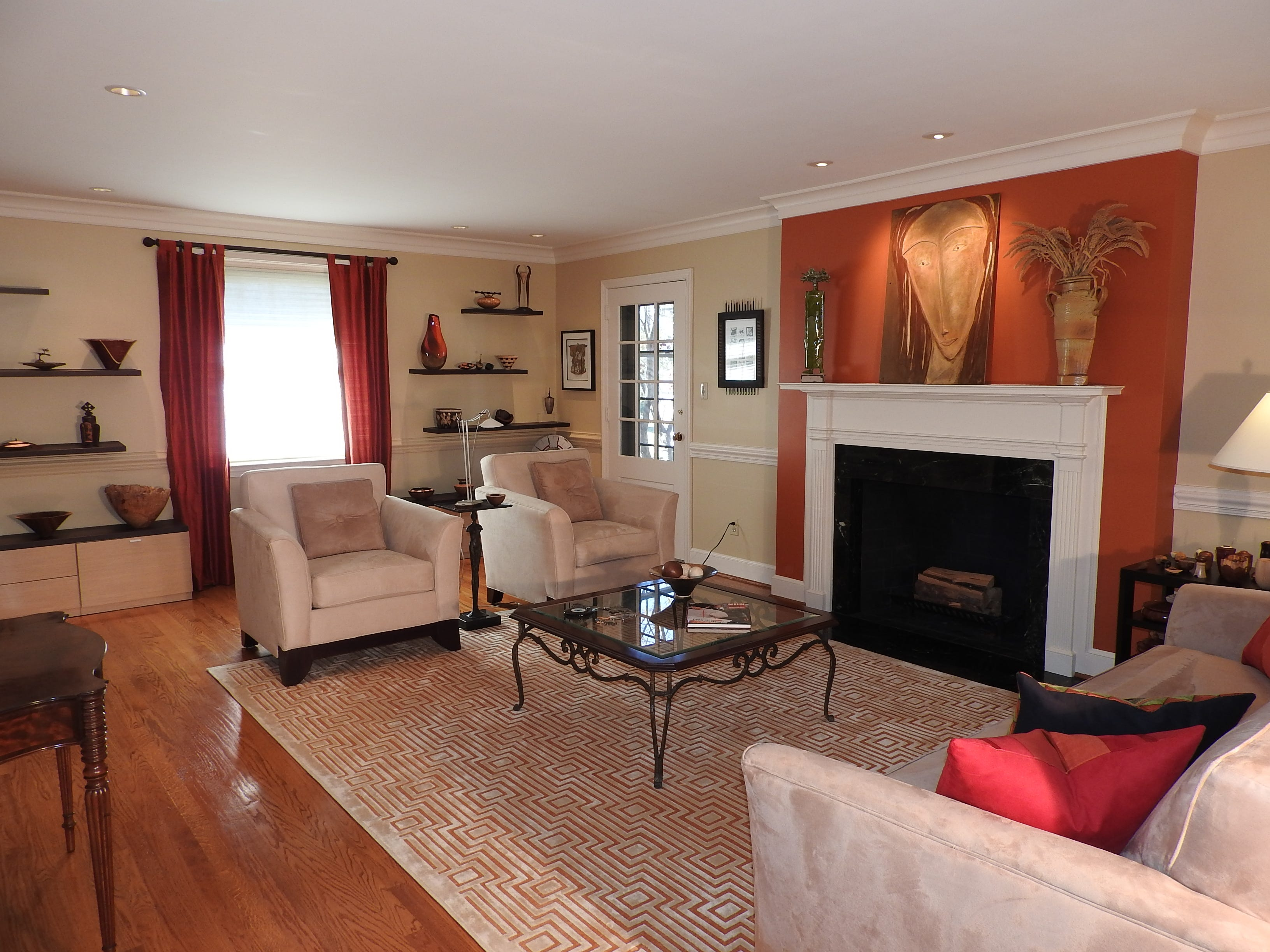 There's a wood-burning fireplace in the formal living room at 103 Edgewood Road in Alapocas.