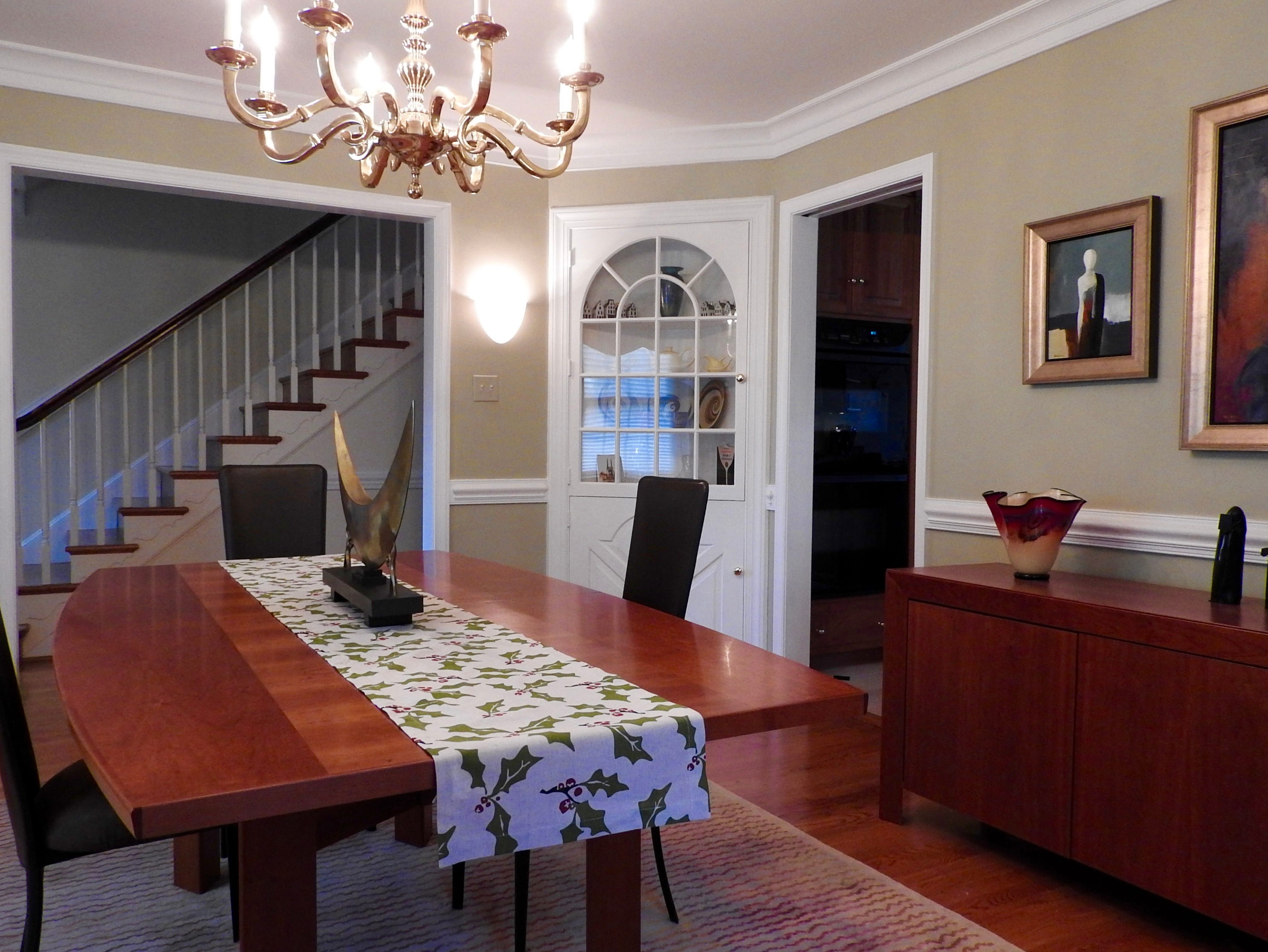The formal dining room at 103 Edgewood Road in Alapocas features a chair rail and crown moldings.