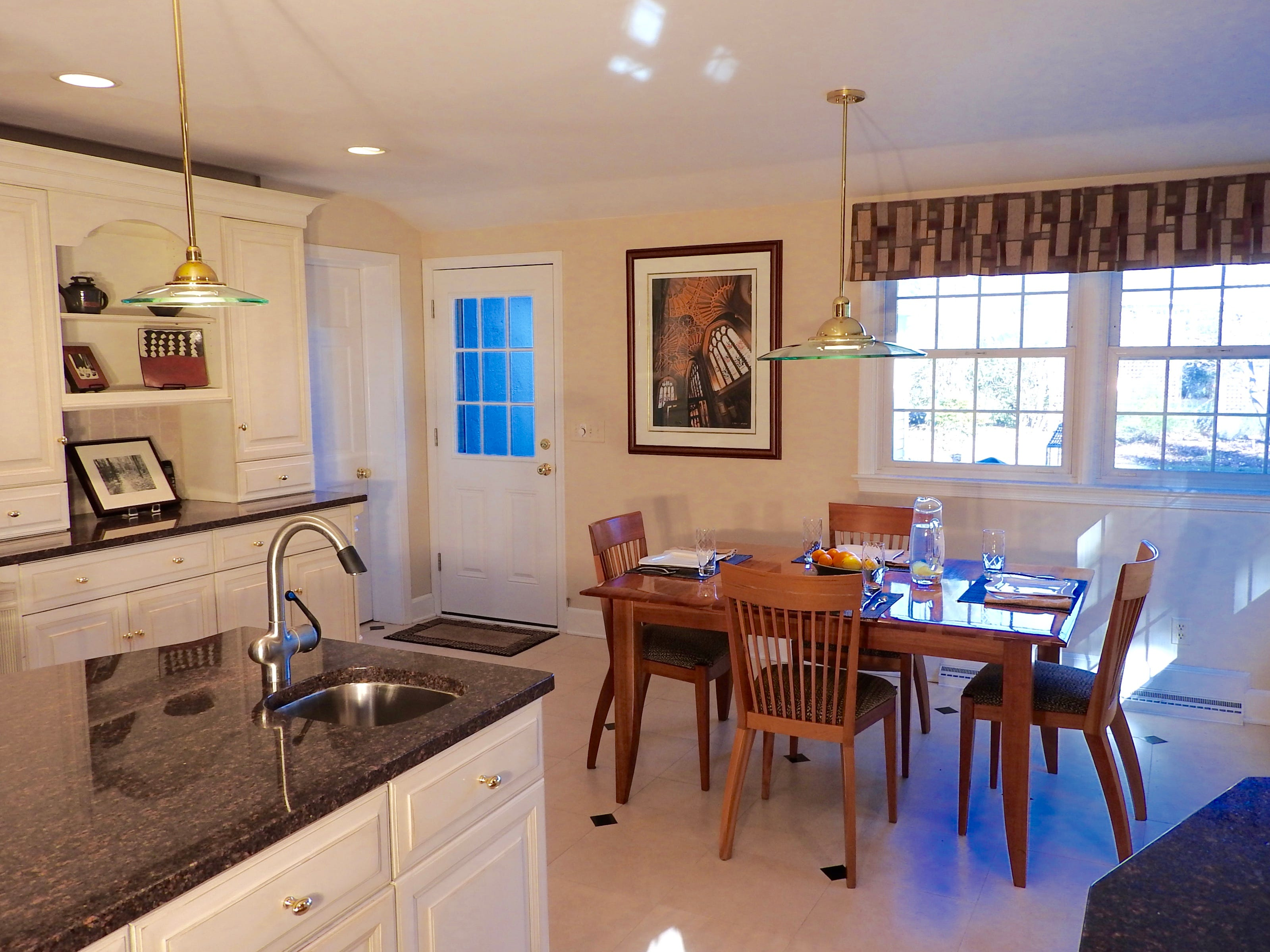 A large eat-in kitchen at 103 Edgewood Road in Alapocas has cherry cabinets,  granite countertops and a breakfast nook.
