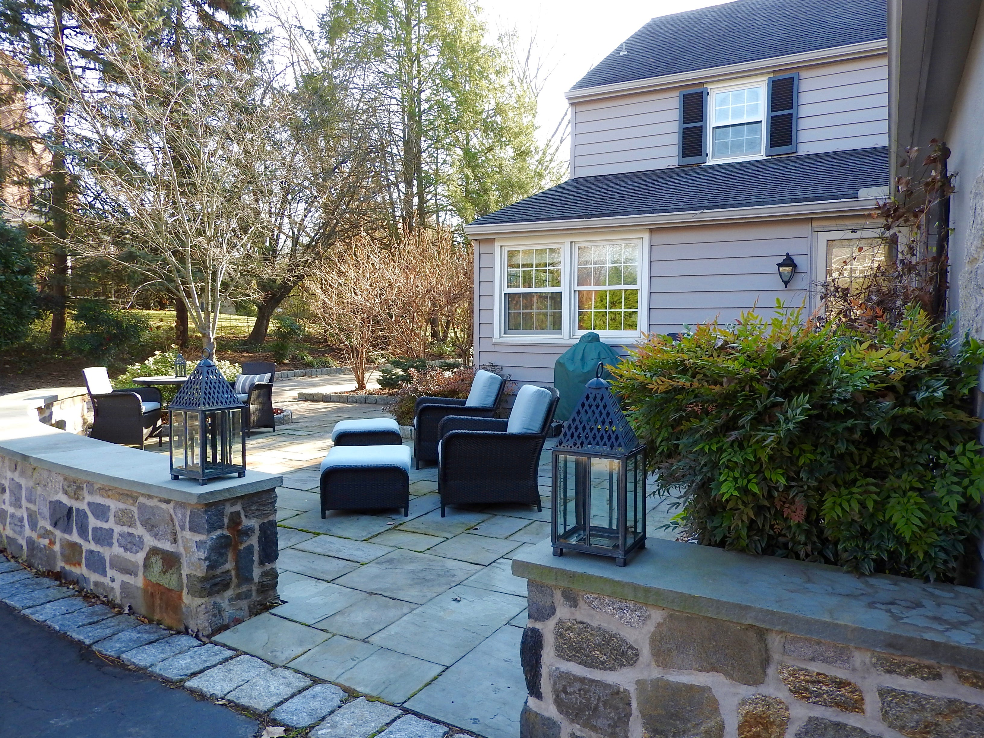 The flagstone patio at 103 Edgewood Road in Alapocas offers a gracious place to entertain guests or end the day.