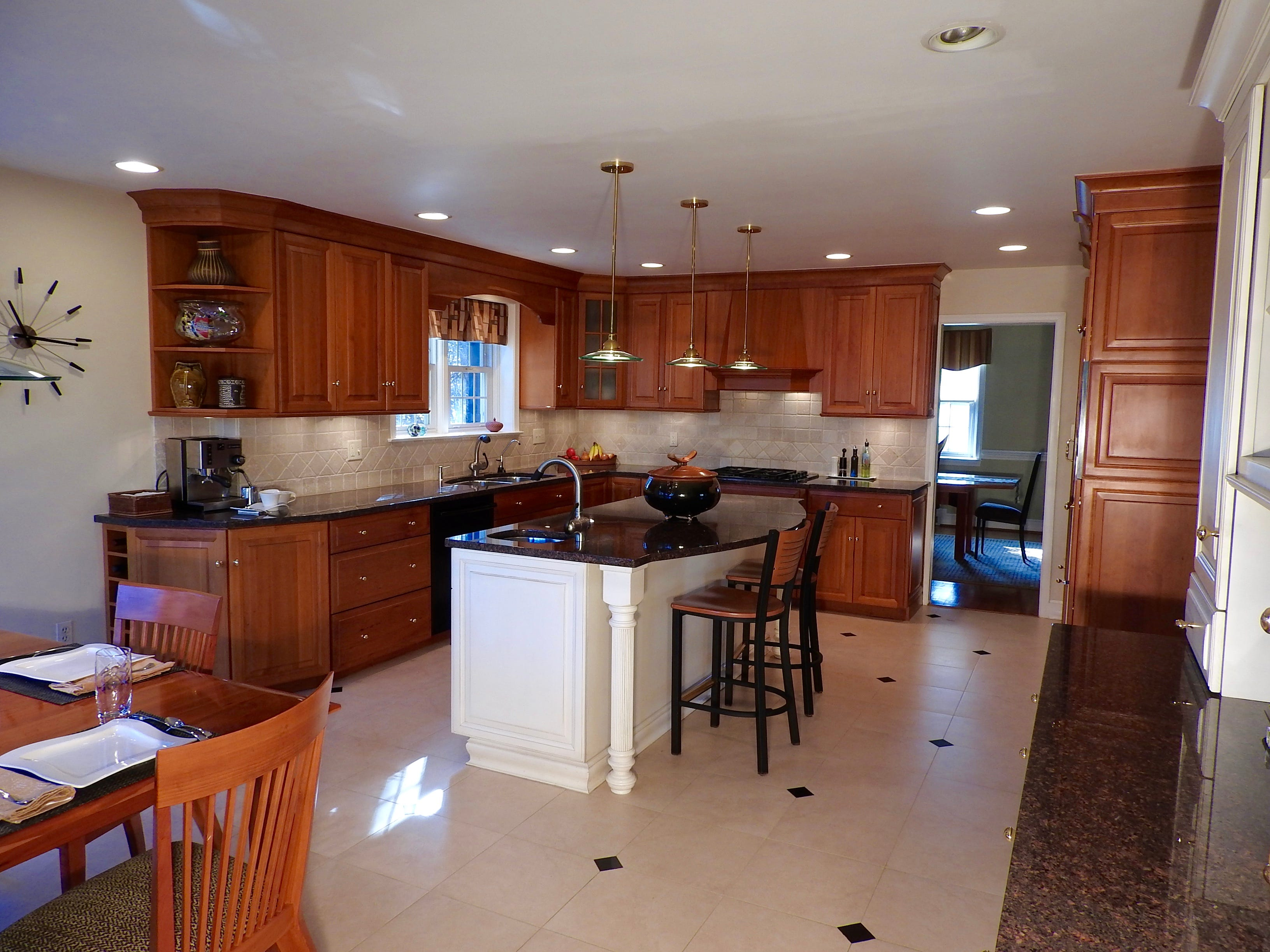 A large eat-in kitchen at 103 Edgewood Road in Alapocas has cherry cabinets and granite countertops.