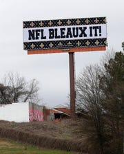 A billboard protesting a controversial call in the Sunday's NFL football game between the Saints and Rams is shown along Interstate 75 near Hartsfield Jackson Atlanta International Airport in Atlanta.