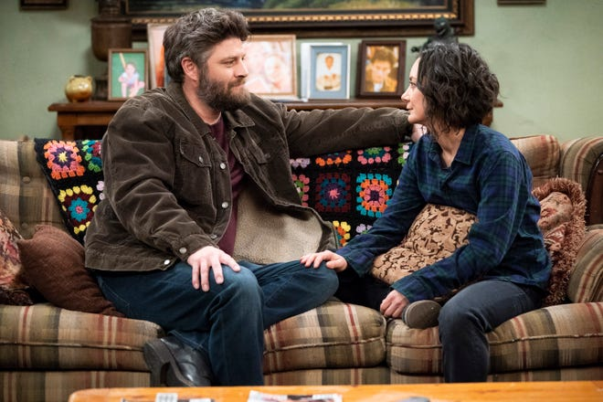 Ben (Jay R. Ferguson) awaits a response from Darlene (Sara Gilbert) to his invitation to move in with him in Chicago in Tuesday's Season 1 finale of ABC's 'The Conners.'