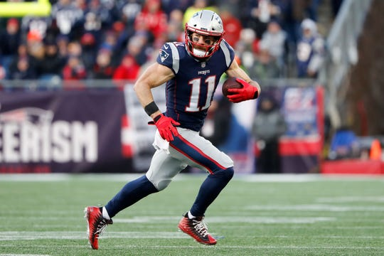 New England Patriots wide receiver Julian Edelman (11) runs against the Los Angeles Chargers during the fourth quarter in an AFC Divisional playoff football game at Gillette Stadium.