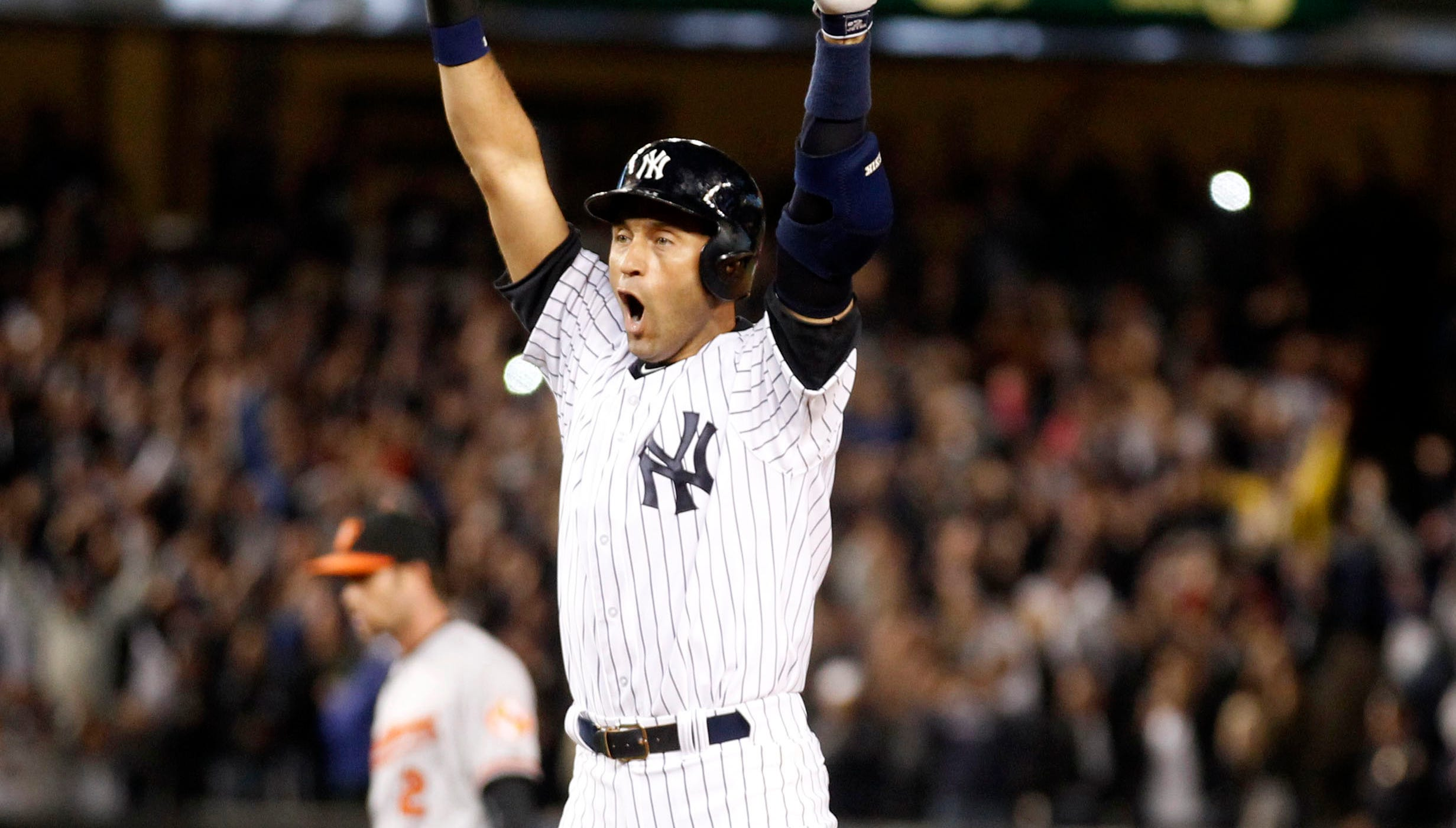 Jeter celebrates after his walk-off single in his final game at Yankee Stadium on Sept. 25, 2014.