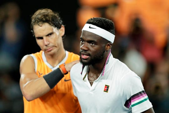 Rafael Nadal (left) is congratulated by Frances Tiafoe of the USA after winning their quarterfinal match at the Australian Open.