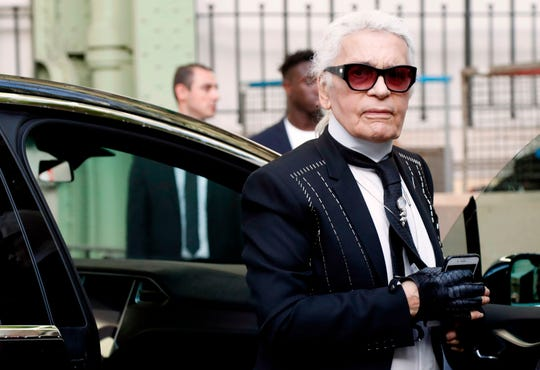 Karl Lagerfeld arrives at the Chanel women's 2018 Spring/Summer ready-to-wear collection fashion show in Paris in October 2017.