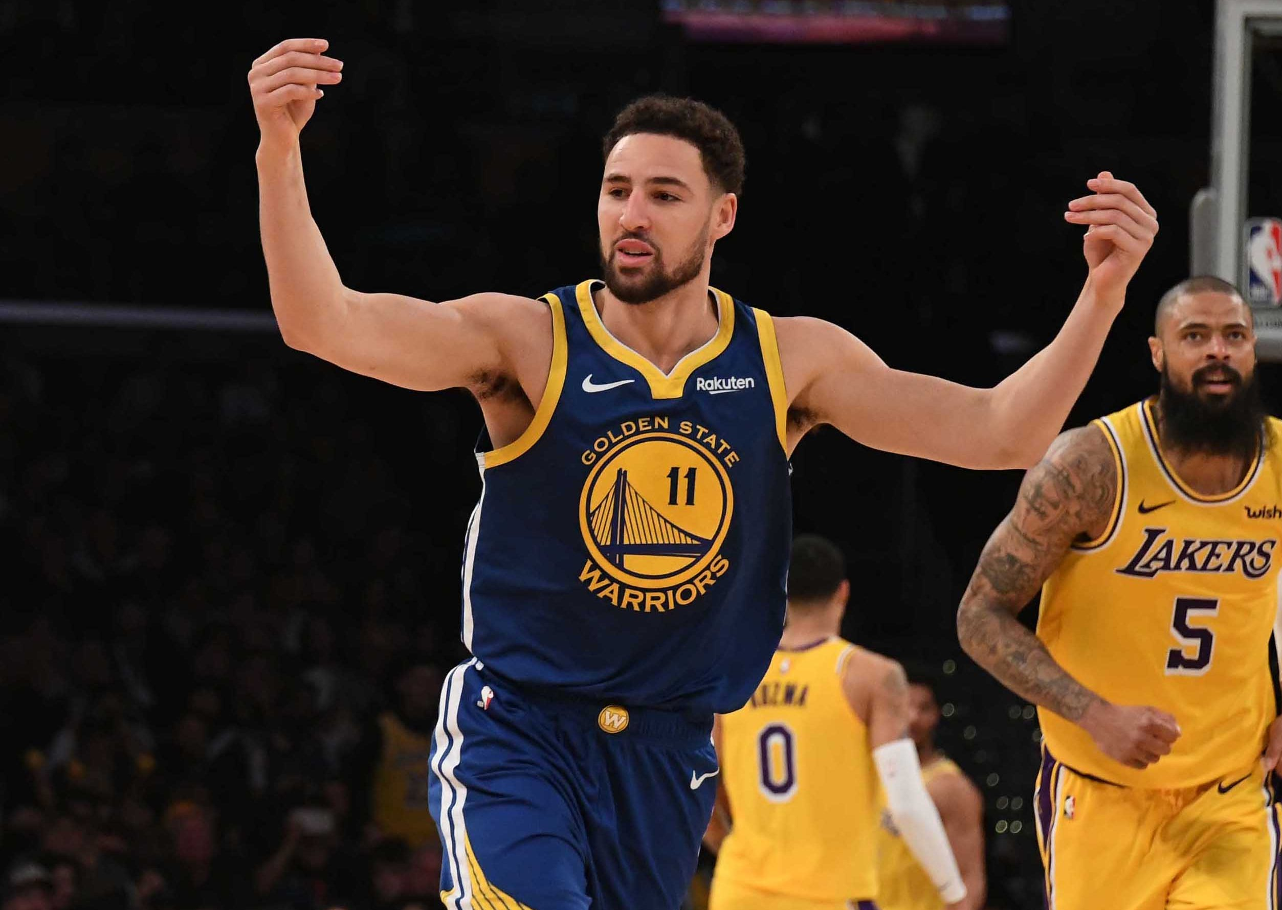 Golden State Warriors guard Klay Thompson (11) celebrates after shooting a 3-pointer against the Los Angeles Lakers.