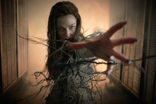 """Evil sorceress Morgana (Rebecca Ferguson) rises from the ground to conquer England in """"The Kid Who Would Be King."""""""