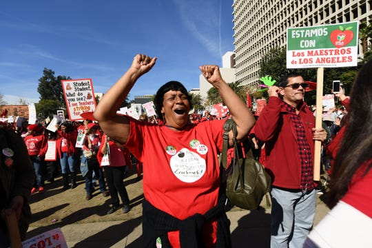 Striking teacher Etheldra Richie dances as music is played during a rally turned celebration at Grand Park in downtown Los Angeles. The teachers union, United Teachers Los Angeles, reached a tentative agreement on a new contract with L.A. Unified School District.