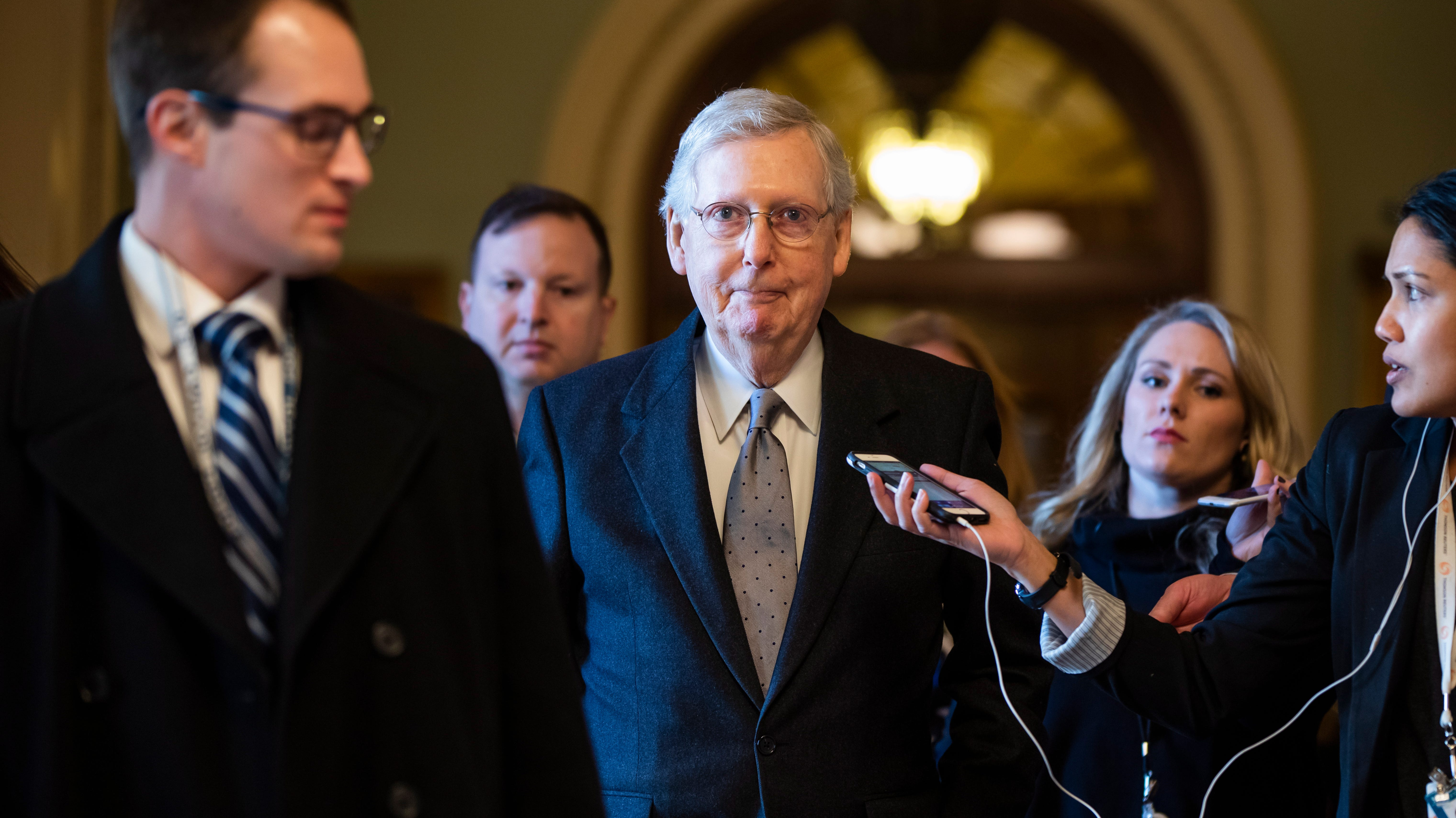 Republican Senate Majority Leader Mitch McConnell walks off the Senate floor as he prepares to enter a bill to end the government shutdown in the U.S. Capitol in Washington, D.C., on Jan. 22, 2019.
